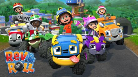 A boy wearing a blue helmet is sitting on a blue truck with big eyes and a pink tongue, surrounded by four other kids sitting in their own trucks.