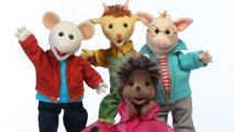 Four stuffed animals, dressed in colourful outfits, waving and standing in front of a white background.