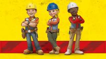 Two male and one female construction workers standing in front of a yellow wall, wearing helmets, tool belts and their arms crossed.