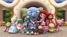 A girl with red hair standing in the middle of a bunch of toys, hugging a large blue elephant.